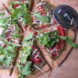 Roasted Red Pepper and Pesto Pizza with Whole Wheat Dough, Arugula, and Parmesan Cheese