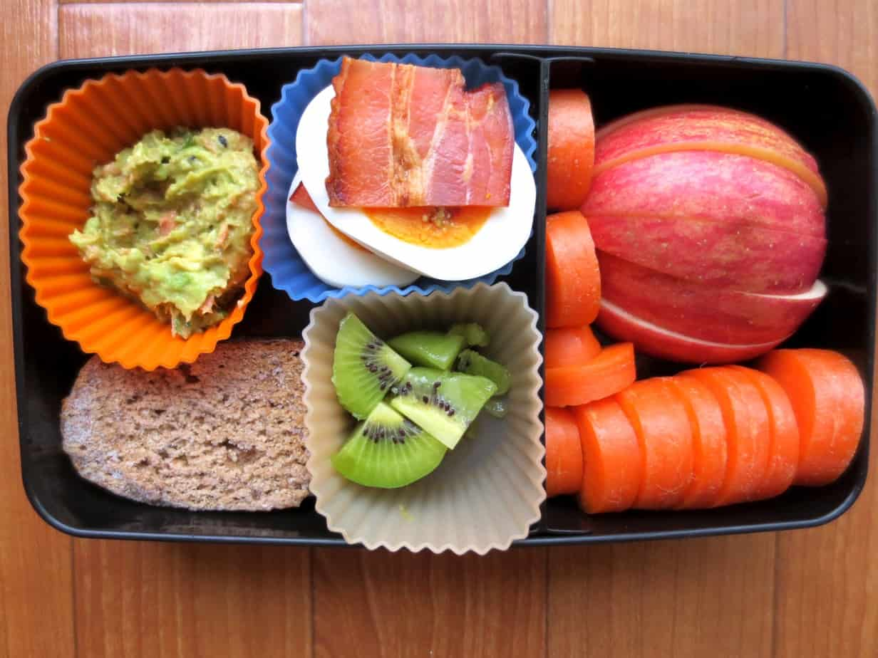 Bento Box with Hard Boiled Eggs, Salmon-Avocado, Whole Wheat Banana Bread, Apples, Carrots