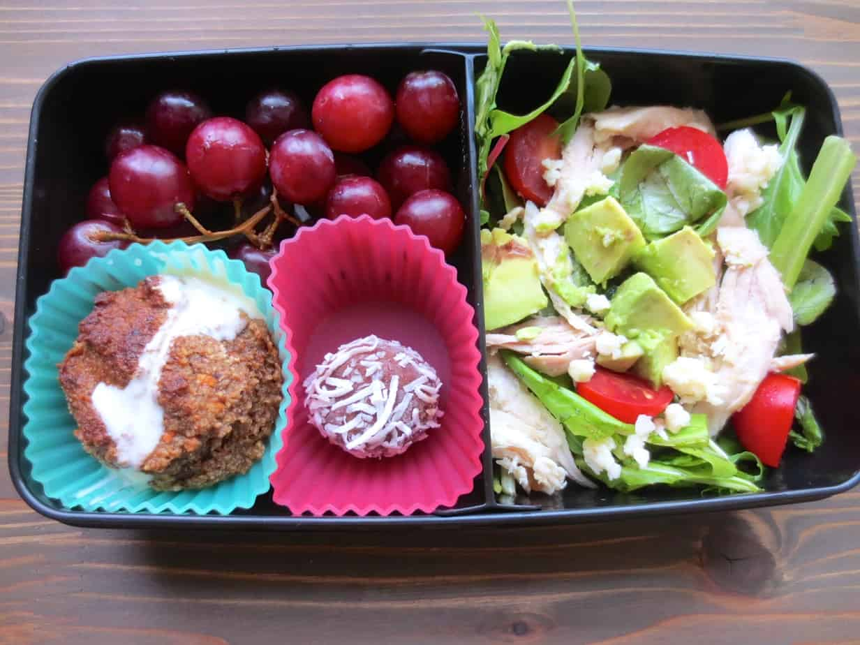Easy Bento Box - Carrot-Banana Muffin, Chicken-Avocado Salad, Peanut Butter Coconut Bite, Grapes #realfood #bentobox #lunch | Frugal Nutrition