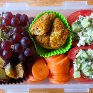 Lunch Box with Stuffed Tomatoes, Almond Crusted Chicken Strips, and Roasted Sweet Potatoes