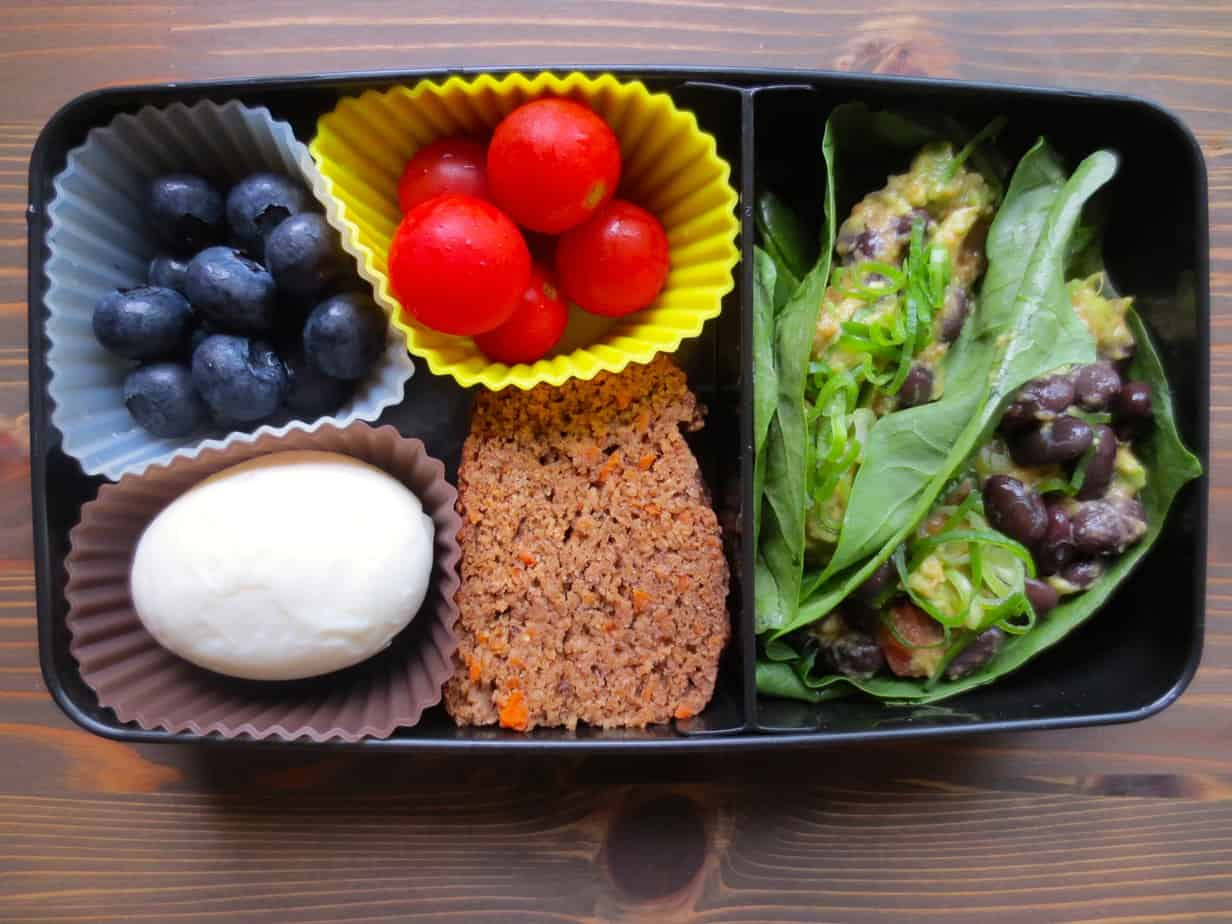Black Bean Avocado Lettuce Wrap, Carrot-Banana Bread, Hard boiled egg, cherry tomatoes, blueberries Bento Box