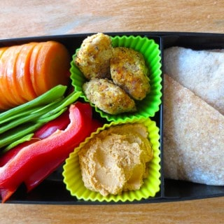 Hummus & Dippers Bento Box with veggies, chicken nuggets, and pizza dough