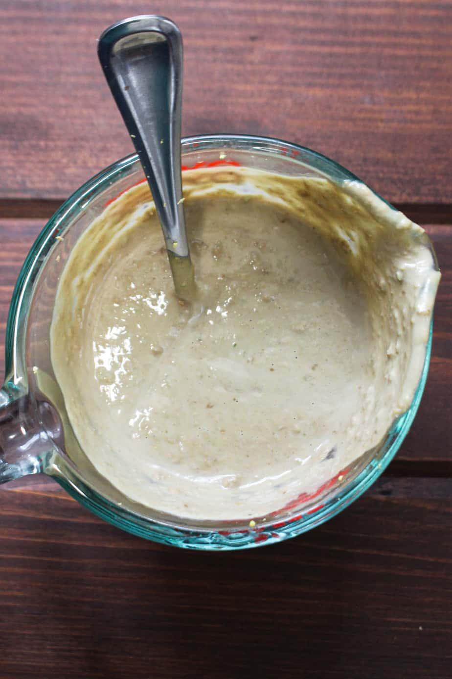 pyrex dish with tan sauce
