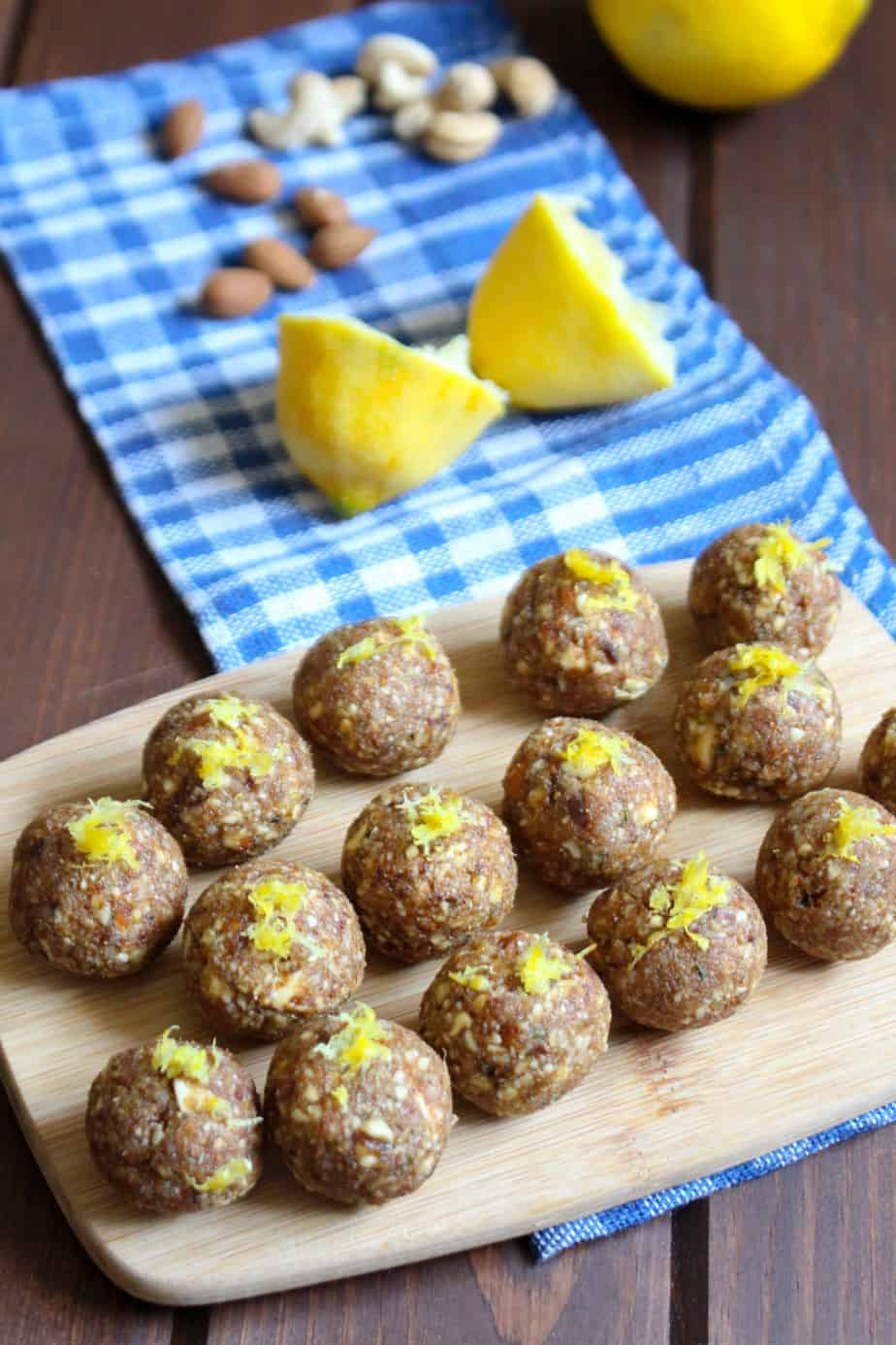 The BEST energy bites with lemon, almond, cashews, and half the sugar. | www.frugalnutrition.com