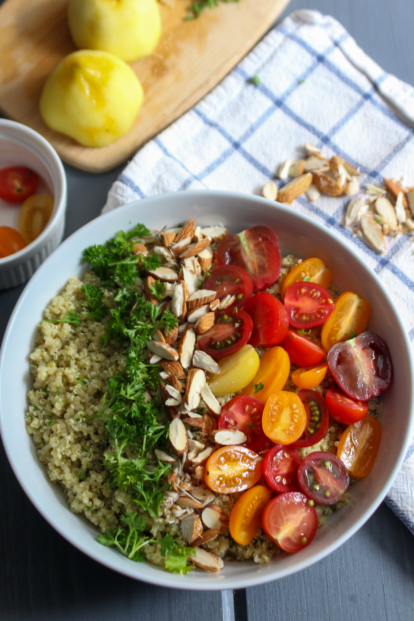 Quinoa salad with parsley, almonds, heirloom tomatoes, and a lemon.