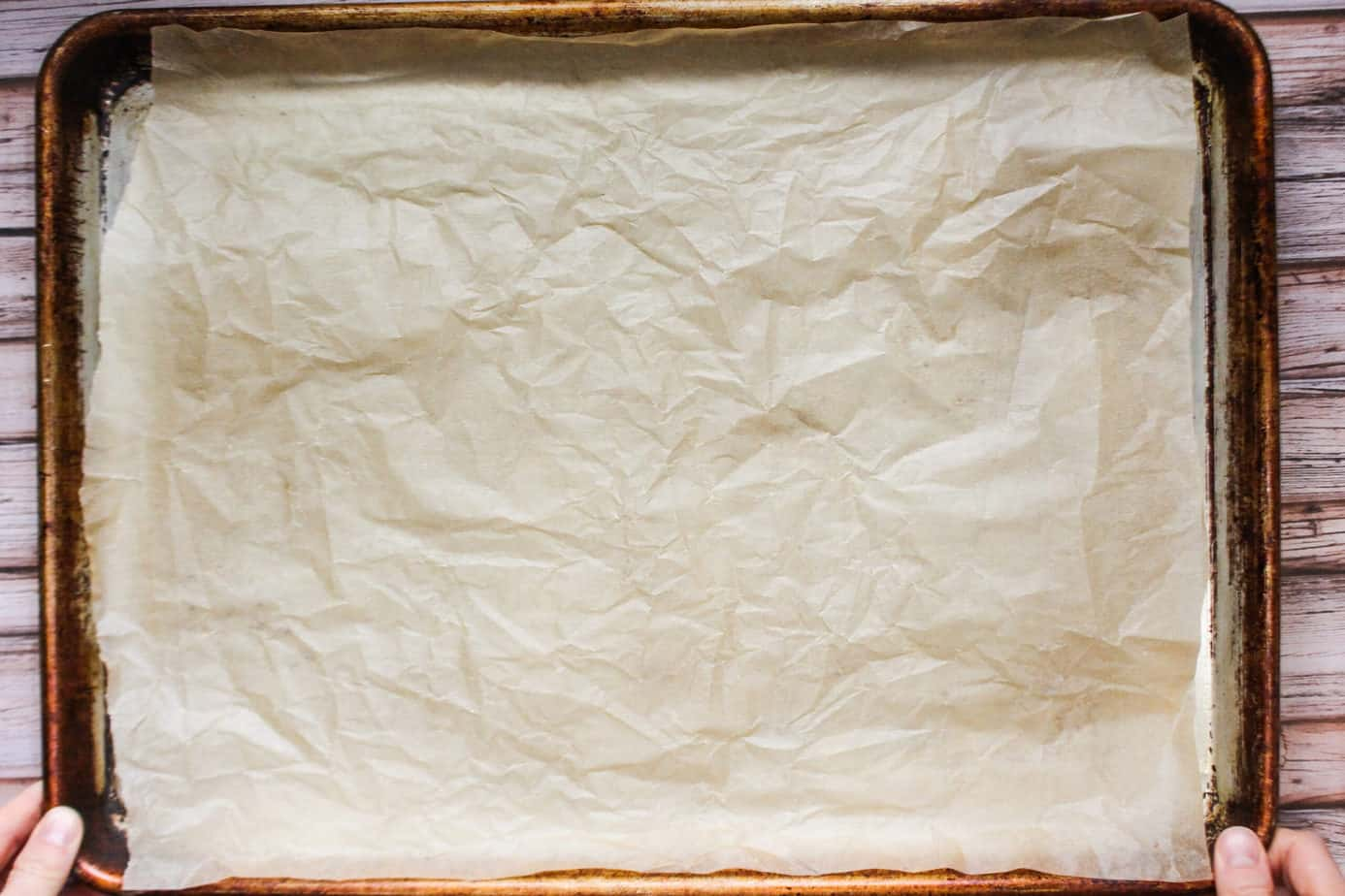 Wrinkled parchment paper on a sheet pan