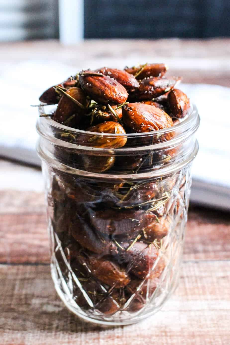 clear glass jar with rosemary almonds