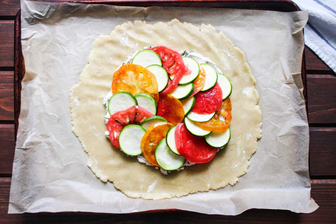 galette pastry dough with zucchini and tomatoes