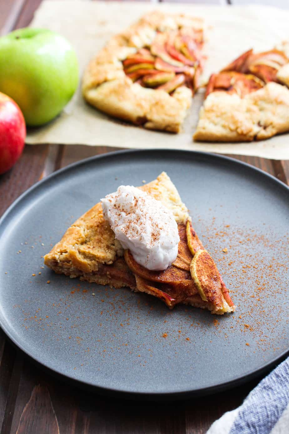 apple pie galette on plate with whipped cream