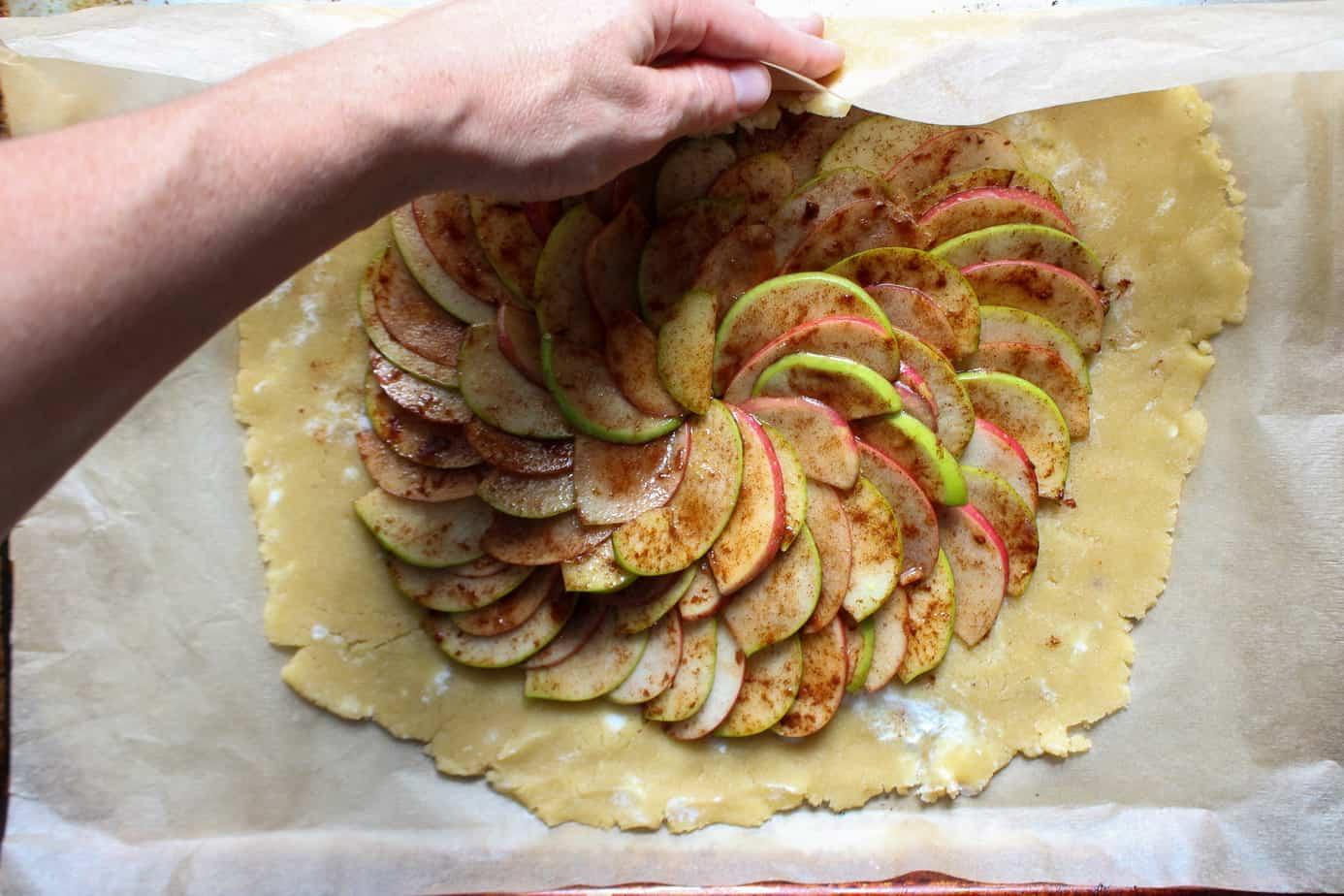 folding the edges of apple pie galette crust